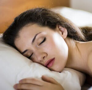 woman sleeping on a pillow, dreaming