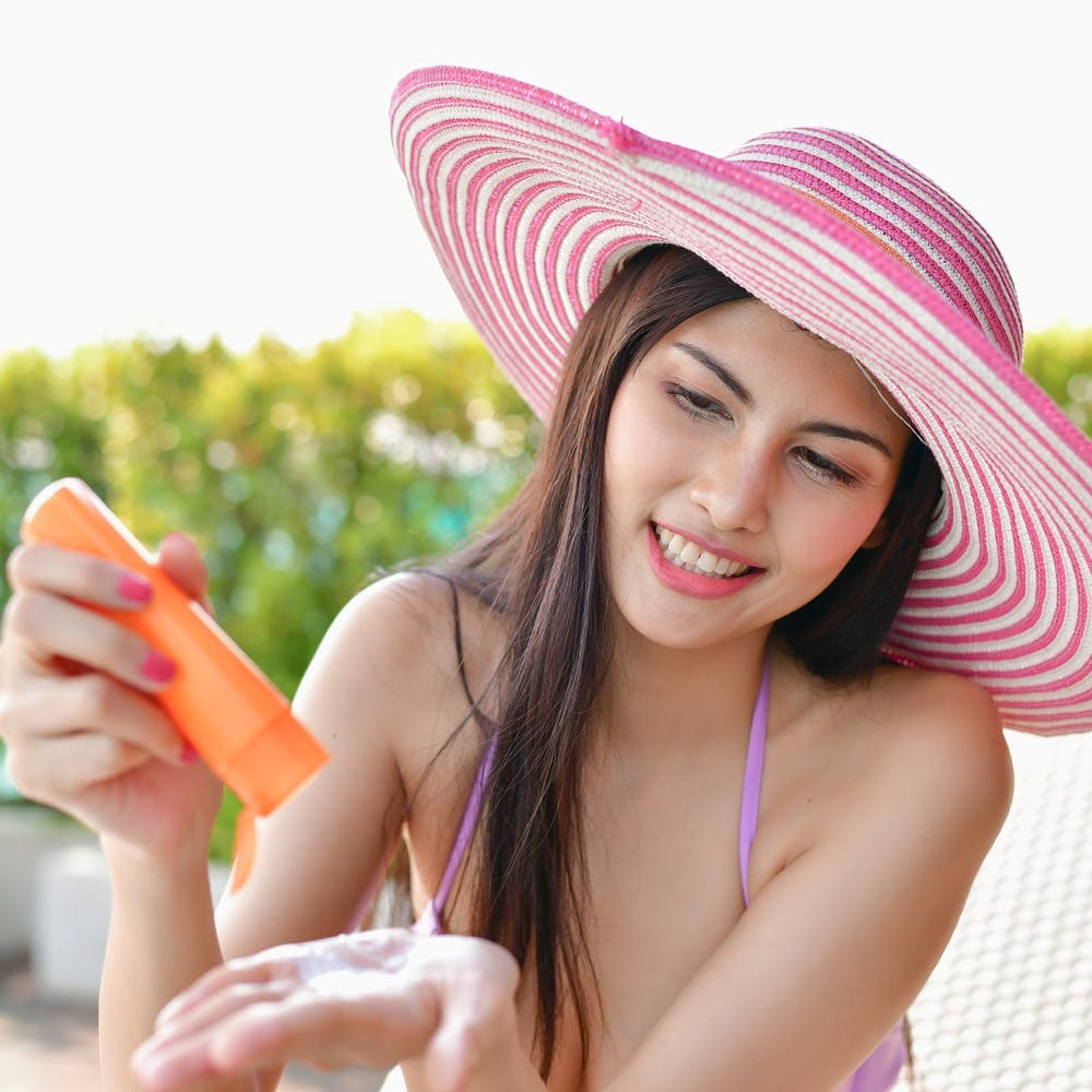 Applying sunscreen for UV protection