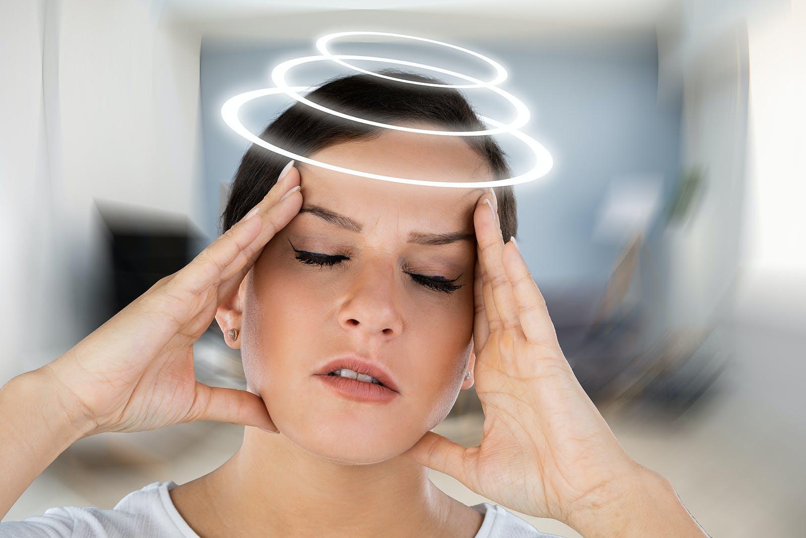 Woman with BPPV vertigo and spinning head