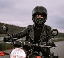 Woman on a motorcycle to illustrate a Rinvoq TV commercial