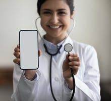 Cardiologist with cellphone and stethoscope discusses CAC scores