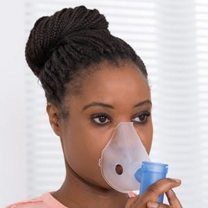 Close-up Of Young African Woman Using Oxygen Mask for cluster headache