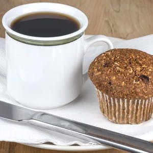 Fresh baked bran and flax muffin and coffee