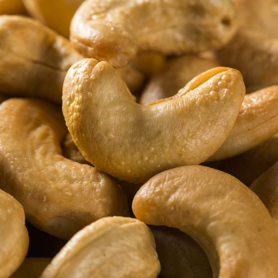 Cashew nuts close up on wood background