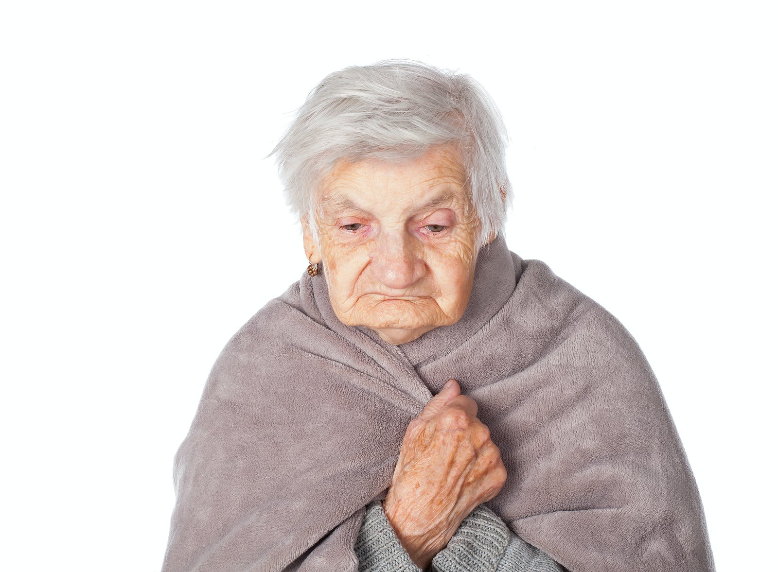 elderly woman wrapped in gray blanket due to respiratory infection, dementia genes
