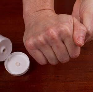 putting lotion on dry hands
