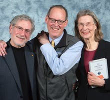 Dr. Paul Farmer with Joe and Terry Graedon at the Bryan Series Talk on Public Health in Greensboro, NC on Feb. 19, 2019