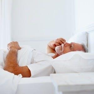man with gray hair asleep